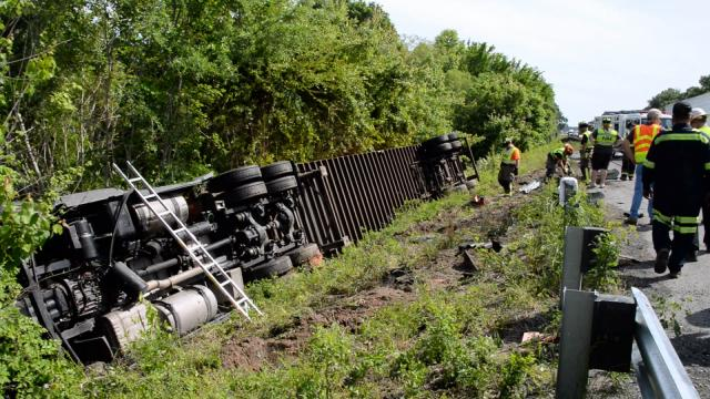 A tractor-trailer overturned along Interstate 95 in Johnston County on May 13, 2015, forcing authorities to close all southbound lanes. (Photo by John Payne)