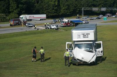 At least one person died Monday in a multi-vehicle crash on U.S. Highway 70 (Business) in Garner.
