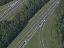 Four people died Friday when their vehicle swerved off Interstate 95, and northbound lanes were closed for hours.