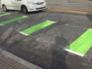 On Hillsborough Street, green markings are part of a test program to make it a little safer for cyclists to transition out of bike lanes and into the main travel lanes.