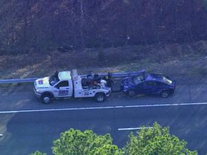 A tow truck pulls a car from the scene of a crash on Interstate 40 Friday afternoon.