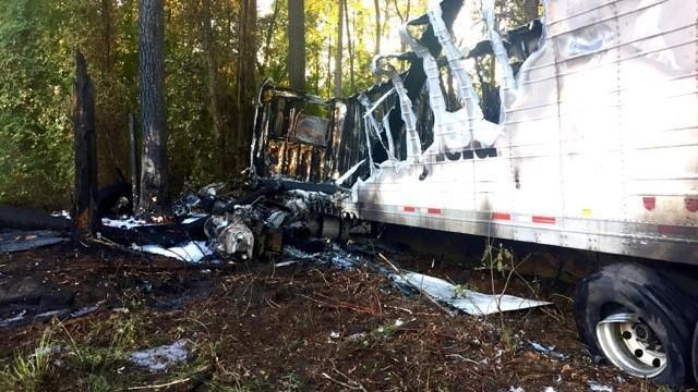 Authorities said that a 2013 Freightliner tractor trailer was traveling south on I-95 at about 6:30 p.m. when the vehicle suddenly reduced speed, ran off the road and traveled down an embankment. Authorities said the tractor trailer struck several trees and caught fire.