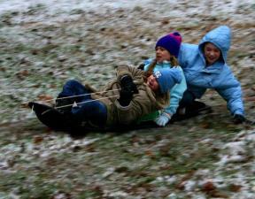 Photo by: Mick Stewart. Savannah Stewart (front) Ellen Price and Taylor Stewart make the best of a little Winter wonder.