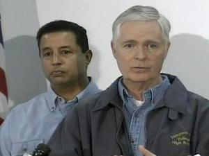 Gov. Mike Easley (front) and Brian Beatty, secretary of Crime Control and Public Safety, (back) talk about the tornadoes that hit Johnston and Wilson counties at press conference in Kenly Monday, Nov. 17, 2008.