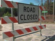 Rains wash out road to subdivision