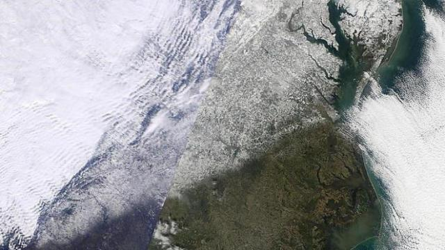 "Snow left behind by the 18-19 Dec 2009 storm is seen here on a satellite image captured on the 20th. The image is included in a storm summary posted as part of the Raleigh NWS ""past events"" collection."