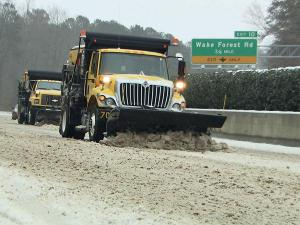 State, county and municipal crews worked to keep roads passable Saturday.