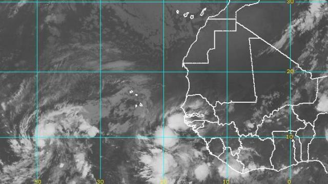 Meteosat view of the eastern Atlantic and west Africa early on Monday 14 June 2010, showing a pair of disturbances exiting  Africa toward the west. The lead swirl of low pressure has a better than even chance of becoming the season's first Atlantic tropical cyclone.