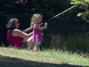 A mother and daughter fish in a shady spot at Lake Wheeler on July 5, 2010.