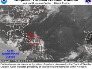 Tropical outlook graphic from the National Hurricane Center highlighting a tropical wave of concern on Wed, 21July 2010.