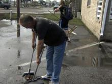 Carolina Beach residents clean up from flooding