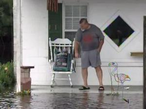 Dave Graves watches flood waters from the Northeast Cape Fear Valley River inch up his home in Pender County.