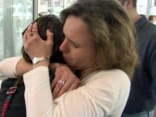 Gloria Young hugs her daughter at RDU International Airport on March 18, 2011, after returning home from Japan. Young's daughter and fellow classmates narrowly avoided an earthquake and tsunami in Japan.