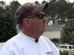 Tim Grant, a volunteer firefighter with the Wake-New Hope Fire Department, checks out damage to his Raleigh home after an April 16, 2011, tornado.