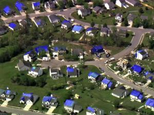 Sky 5 shows Raleigh homes dotted with tarps after the April 16 tornadoes.