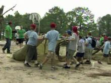 Boy Scouts clean up storm damage