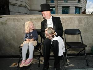 4-year-old Camille Corey of Raleigh gets up close with Sir Walter Wally during the Groundhog Day event at the North Carolina Museum of Natural Sciences in downtown Raleigh.