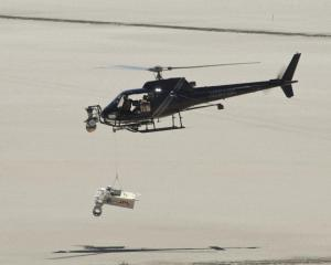 Drop-testing of landing radars in the California desert. (Courtesy NASA/JPL)