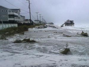 N.C. Highway 12 in Kitty Hawk is covered with surf and sand from Hurricane Sandy. (Photo by N.C. DOT)