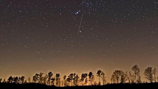 Geminid meteor appears to pass through the constellation Orion early this Friday morning from Northampton County (Ken Christison)