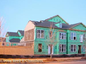 Just a week after high winds blew down a condominium under construction near Raleigh's Brier Creek, rebuilding has already begun.