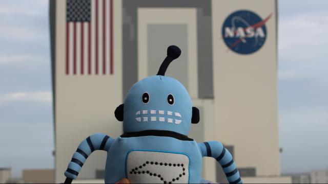 """Kelvin, official """"spokesbot"""" for the NC Science Festival, on a recent visit to the Kennedy Space Center (Credit: Tony Rice)"""
