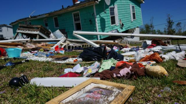 Gov. Pat McCrory toured three eastern North Carolina counties, including this home in Beaufort County, on Sunday, April 27, 2014, to survey damage from tornadoes that struck the state two days earlier.