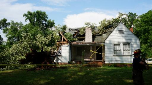 A tree destroyed a home on Miami Boulevard in Durham after storms passed through the area. (Adam Owens/WRAL)