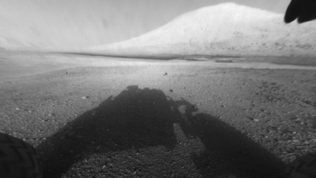 The first image returned from Curiosity showed it was safe on Mars and its main science target, Mount Sharp. (NASA/JPL-Caltech)