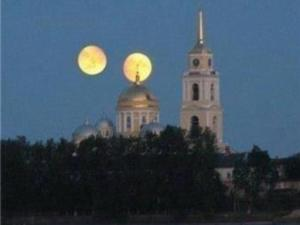 "This image of ""twin moons"" over the Nilov Monastery in north-eastern Russia claims Mars close approach to Earth will make it appear as large as the full moon. (Image credit: unknown)"
