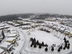 Drone video: Snow falling over Cary neighborhood