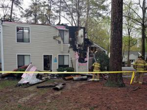 One person was injured and a total of five were displaced early Friday after lightning sparked a fire at an apartment complex on Courtney Lane in north Raleigh.