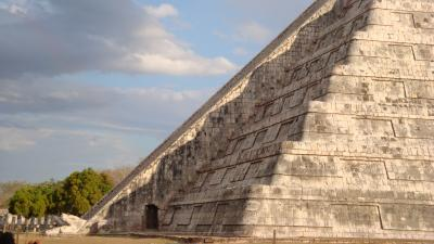 A snaking shadow ending at a feathered serpent head appears on Mexico's Chichen Itza temple during each equinox. (Photo: Bmamlin)