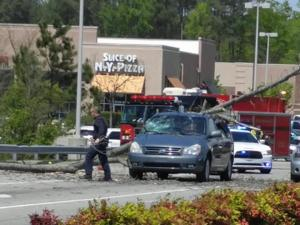 A falling tree crushed two cars in Knightdale Saturday (Photo from Aaron Dowen on Twitter)