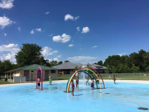 Kids cooled off at local pools as the heat index reached 109 in some places Thursday.