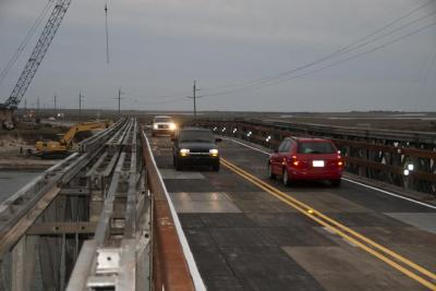 Six weeks after Hurricane Irene cut new inlets along N.C. Highway 12 in the Outer Banks, the state Department of Tranportation opened a new bridge restoring the connection to the mainland. (Photo by Donny Bowers)