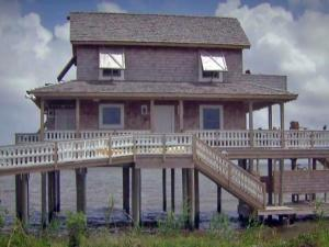 The Beasley family saw its favorite beach rental home destroyed by Hurricane Irene in August 2011. This week, the family returned and was greeted by Hurricane Arthur. Instead of leaving, the family stayed put during the intense storm.