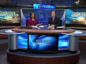 Pam Saulsby and Bill Leslie anchor at the new set on Sept. 27, 2011.