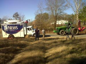 A tractor pulls a WRAL truck out of a ditch on Jan. 6, 2012. (Photo by Tara Lynn)
