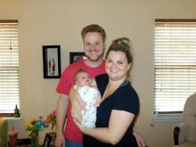 WRAL-TV systems administrator Phillip Boyd, his wife, Kristin, and their son, Blake. (Photo courtesy of the Boyd family)
