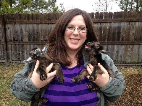 Michelle Henley holds newborn goats, Greg and Fishel