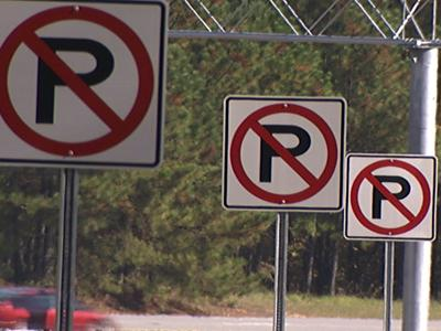 "The state DOT says it's saving taxpayer money by posting 39 ""No Parking"" signs along one exit ramp off I-40."