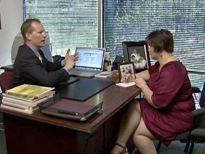 Career coach John O'Connor is advising Kathy Walker on her job search.