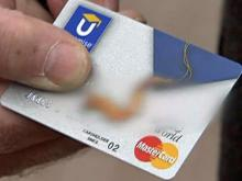 U.S. government takes on credit card companies