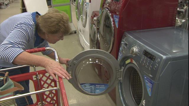 A federally funded rebate brought appliance shoppers to the stores Thursday.