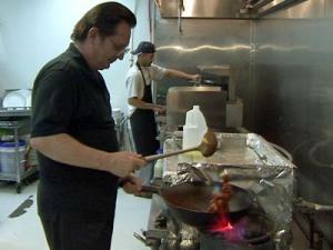 Myong's co-owner Joseph Sulitch prepares a meal.