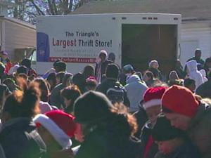 Hundreds lined up for groceries, clothes and toys at the Durham Rescue Mission Thursday.