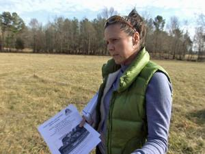 Sherry Gilliland says she paid Curtis Hare, owner of Deep Creek Log Homes, to build a log home, but didn't get anything more than plans.
