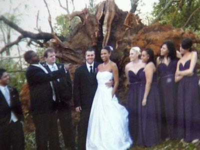 The Duncans posed for a less than typical Kodak wedding moment in front of a huge uprooted tree on April 16, 2011.