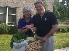 WRAL's chief meteorologist Greg Fishel and Inter-Faith Food Shuttle co-founder an executive director Jill Staton Bullard on May 20, 2011.